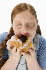 overweight girl eating pastry, portrait