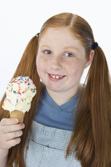 Overweight girl holding ice cream cone, portrait