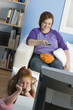 Overweight girl and mother watching television