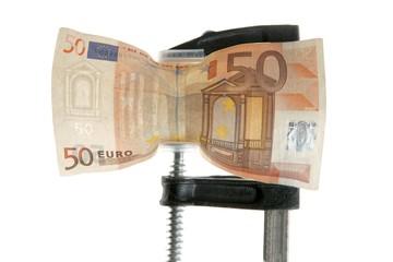 Euro bank note under pressure