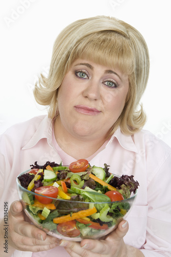 Woman Showing Disappointment Over Salad