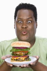 Man Holding Hamburger