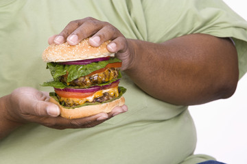 Man Holding Hamburger