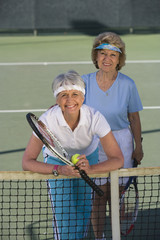 Two female tennis players on court