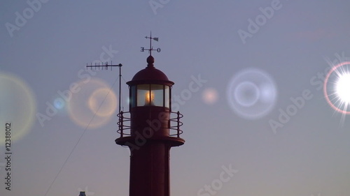 Lighthouse lighted at beautiful sunset