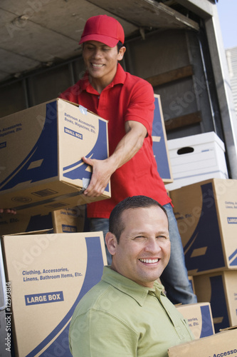 two man unloading delivery van