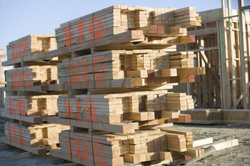 Building construction and Stacks of Planks
