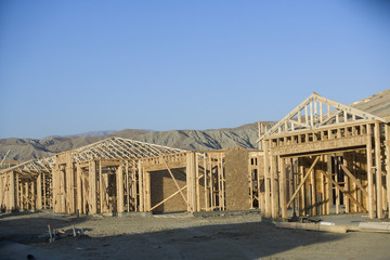 Houses under contraction, mountains in background