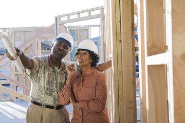 Man and woman at construction site, talking