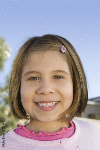 Close-up portrait of girl 5-6, smiling
