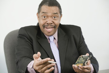 Businessman with a microchip