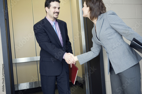 Businesspeople at an elevator