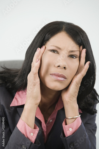 Businesswoman holding her head