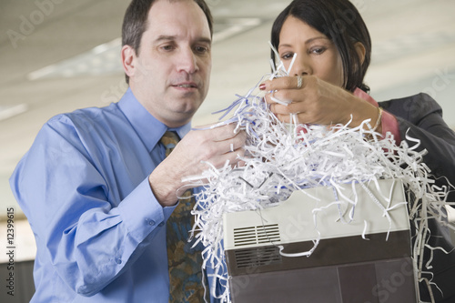 Businesspeople at a shredder