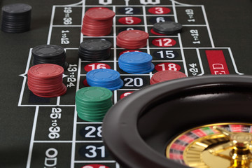 Close up,  Roulette on table with chips