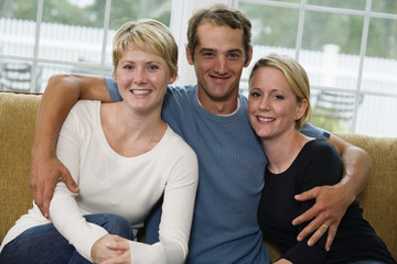 Portrait of a man with twin sisters.