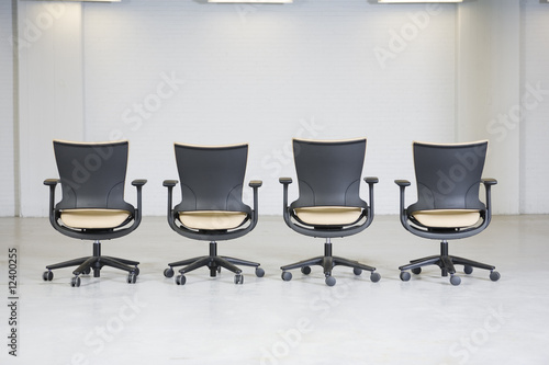 View of empty office chairs.