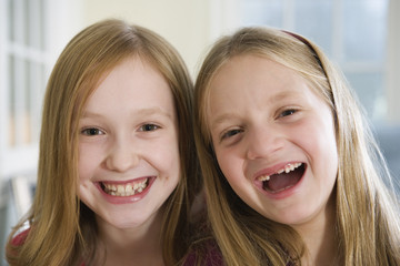 Portrait of two sisters laughing.