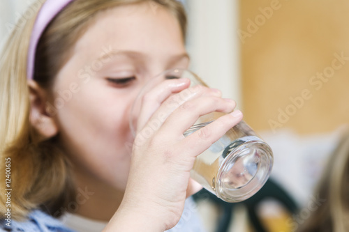 View of girl drinking water..