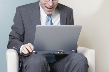 View of a businessman working on the laptop.