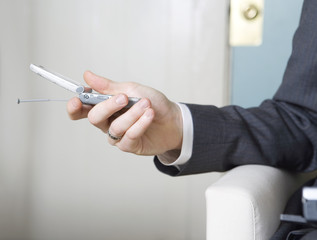 Close up of a man holding mobile phone.