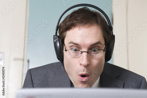 View of a business man wearing headphones.