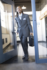 A young business man entering an office.