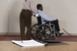 View of business man on wheelchair.