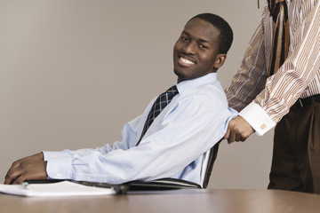 A business man sitting on wheelchair.