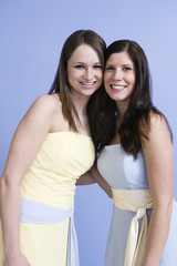 Portrait of two bridesmaids standing together.