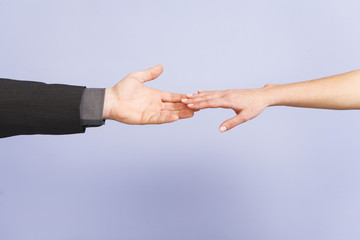 Close up of hands touching.