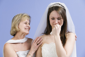 View of a mother consoling daughter.