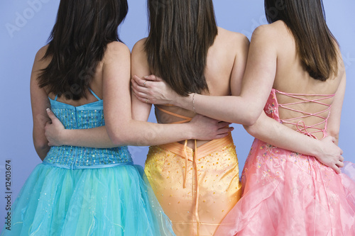 View of friends wearing prom dresses.
