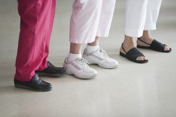 Three senior women's feet