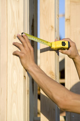 Measuring wooden elements of house construction