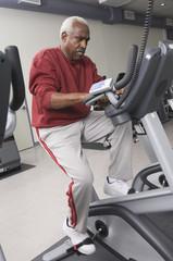 senior man exercising on stationary bike