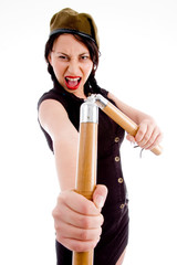 violent young female holding nunchaku