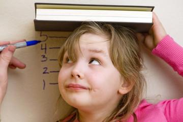 child watching herself get measured