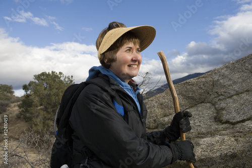 Senior woman hiking in mountains
