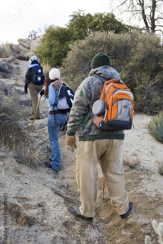 Three hikers on the trail