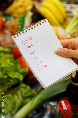 Shopping at the supermarket with a shopping list, French