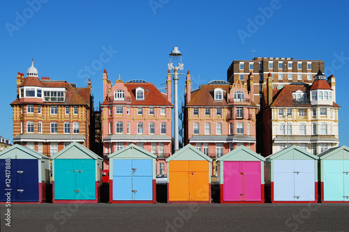 Leinwanddruck Bild Colored beach huts at Brighton. East Sussex. England