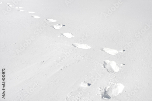 snow footprints in a pure white snow landscape