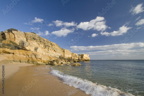 Idyllic wild beach in summertime at  Algarve, Portugal