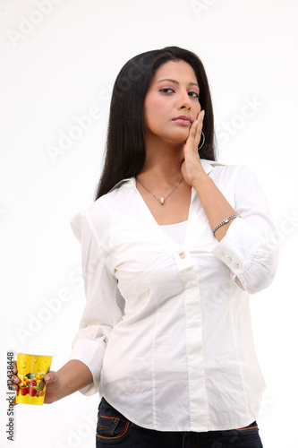 fashionable girl with white shirt and yellow mug