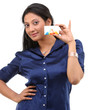Stylish girl with blue shirt holding credit card