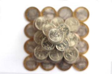 pyramid of coins isolated on white background from above