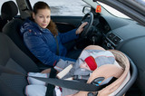 Mother and child in car safety seat poster