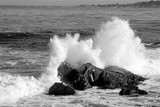crashing waves on boulders poster