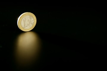 Euro currency coin macro with reflection